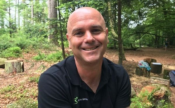 Gareth from Active Devon smiling in a forest